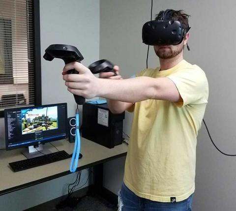 A man wearing the VR goggles