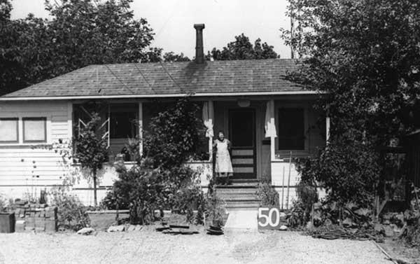 Woman standing in front of a house.