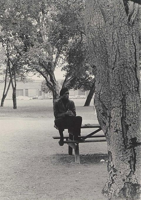 A man sits on a picnic table.
