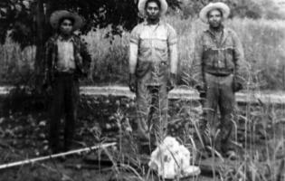 3 men in a field.