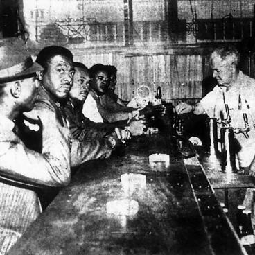 4 men being served in a bar