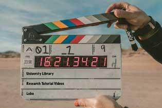 Clapperboard marking the end of a scene.