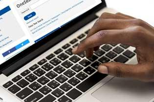 Closeup of a hand typing on a keyboard