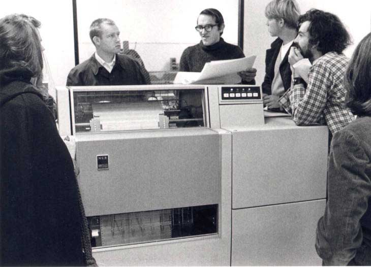 Students surrounding a large computer.